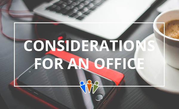 office space, desk, laptop, phone